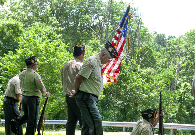 Veterans with American flag.
