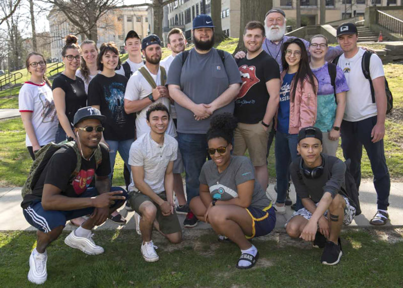 David LaBelle joins his college photography class in a group photo