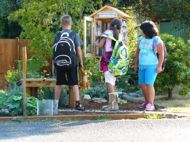 Children check out books available at a Little Free Library in Mountlake Terrace, Washington.